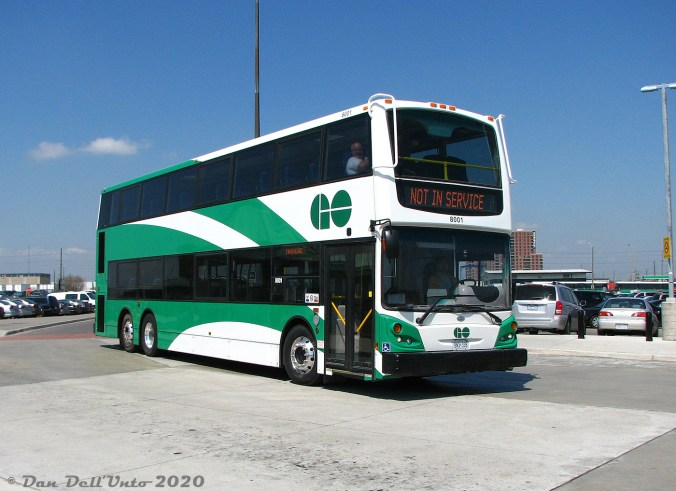 A double decker bus sits parked.