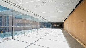 Image shows a glass wall passageway.