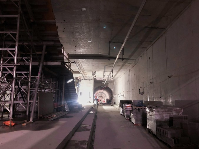 The view inside Fairbank Station with scaffolding and construction workers present