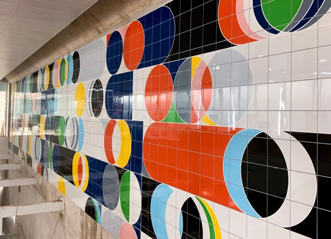 At Science Centre station, the artwork 'Total Lunar Eclipse' by Sarah Morris has now been completely installed. Art work looks like a bunch of tiles, with circles and colours.