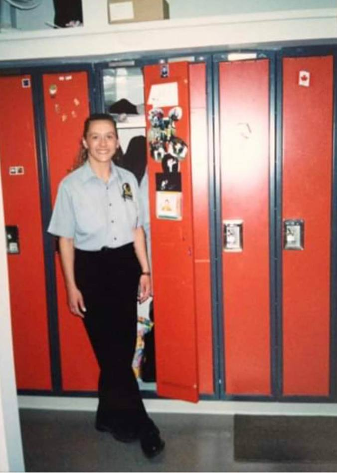 Image shows the driver in front of lockers.