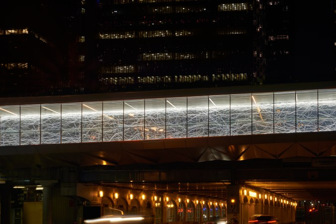 Image shows the pathway lit up at night,