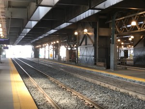 Image shows an elevator across from tracks.