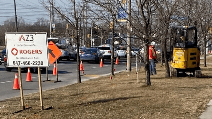 This work crew is using a direction drilling technique to move fibre optics cables for Rogers Communications along Eglinton Avenue West at Martin Grove Road, the future site of a station on the Eglinton Crosstown West Extension. Working in the boulevard minimizes the impact on traffic.