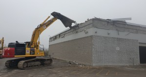A tractor tears into a building during demolition.