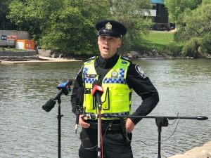 An officer speaks to the media