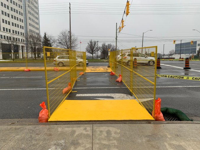 Image shows a crosswalk with barriers on both sides.