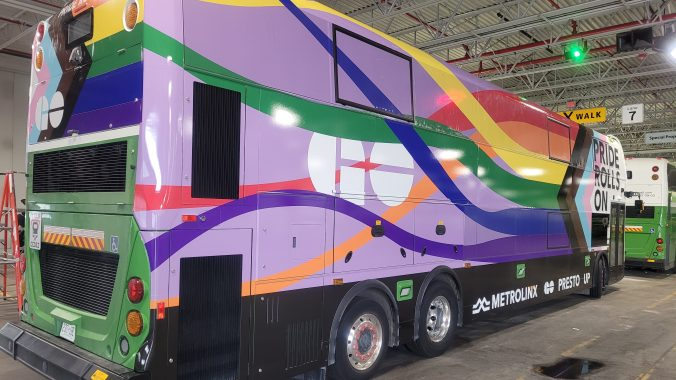 The special wrapped rainbow pride GO bus