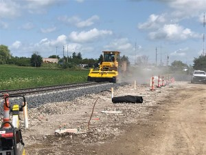 Image shows a machine working on the track section.