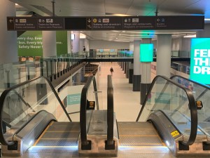 Image shows transit signs and an escalator