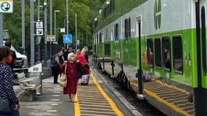 Image shows customers on a platform