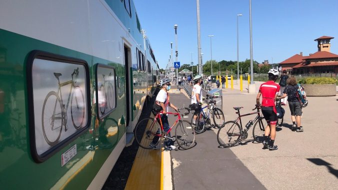 Customers exit a train with bikes