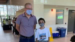 Image shows Phil Verster with the young rail fan