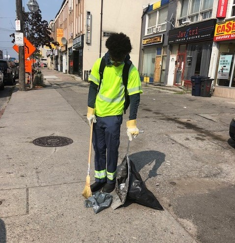 City worker sweeping up trash