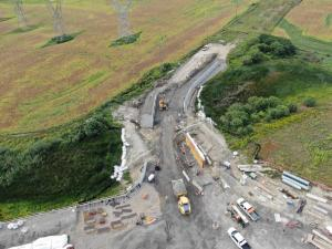 Image shows trucks lined up and working on the site.