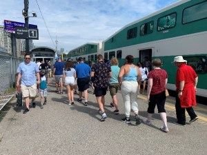 Travellers exit a GO Train.