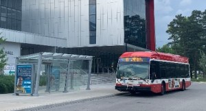 Image shows a bus at a stop.