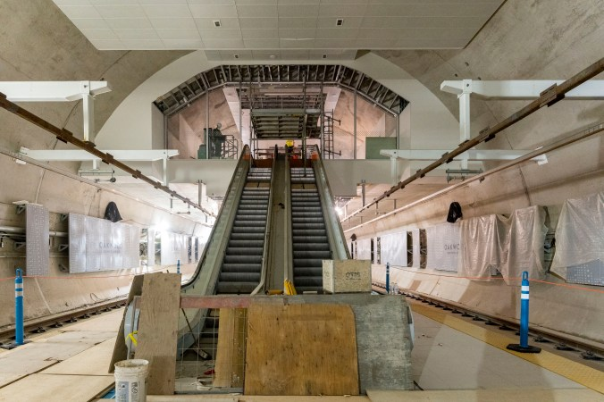 Image shows escalators running down to track level.