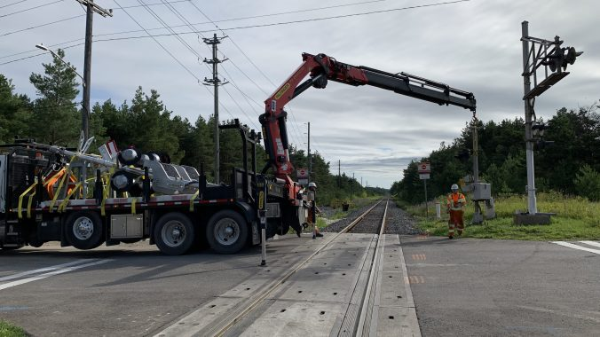 Construction crews installing a new rail crossing arm at Watson Road North in Guelph. (Metrolinx photo)
