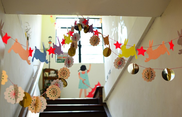 photo of a school stairwell with bright decorations