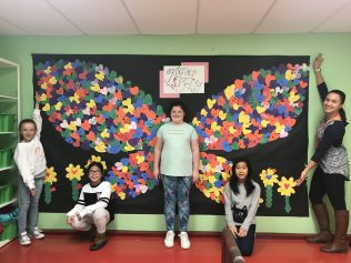 "TOGETHER WE FLY at Cunningham! Cunningham students wrote the word love in any language they chose on a heart to create these colorful heart wings. For students, the wings represent their inclusive school and the idea that alone we are ""just"" a feather and ""Together We Fly!"""