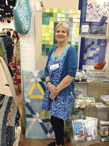 While I interview most Moda designers by phone, others, including Brigitte Heiland, Janet Clare,  and Jen Kingwell live overseas, so Market is the perfect time to find out what's new. Here's Brigitte at Fall 2014 Market.