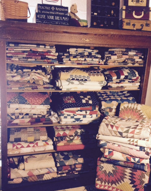 cupboard of antique quilts