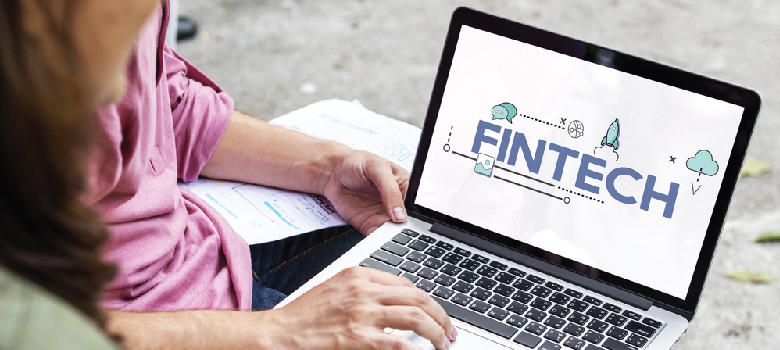 Person browsing Fintech on Laptop