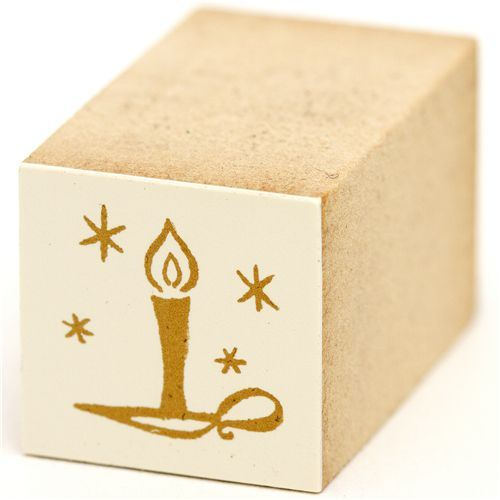 beautiful small candle with star wooden Christmas stamp