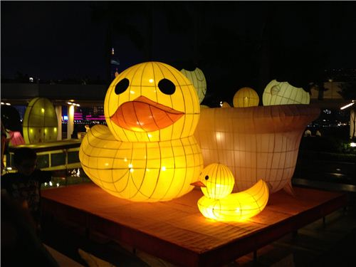 Lanterns at Victoria Harbour in Tsim Sha Tsui showing rubber ducks and people having a bath
