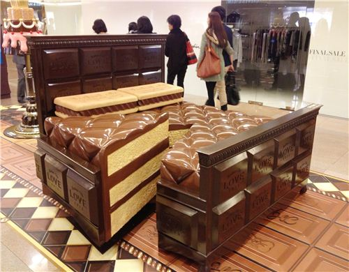 A bed made from cake and cookies