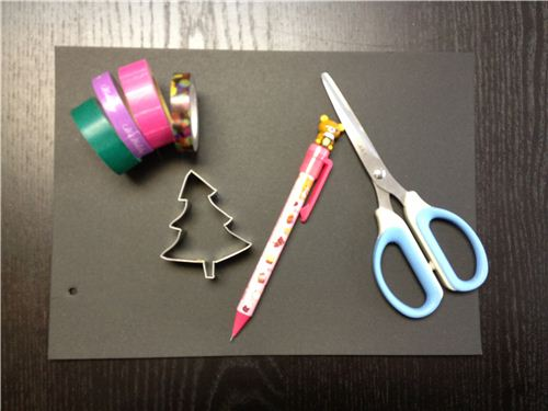 You need cardboard, Washi Tapes, scissors, a pen and a cookie cutter
