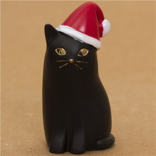 cute black cat with red Santa Claus hat from Japan