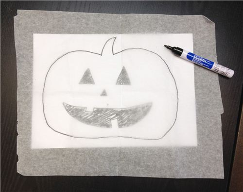 Trace your Halloween designs onto the wax paper and stick the Washi Tapes onto the pattern (make sure the tape strips always overlap a little