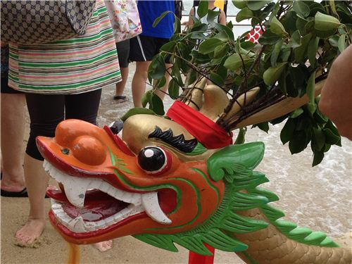 A dragon head on one of the boats