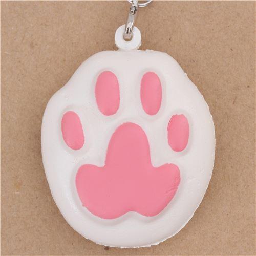 kawaii white animal squishy charm with pink cat paw
