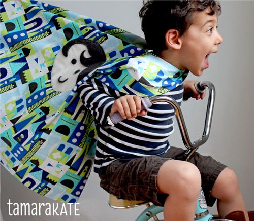 What a fun picture! We love the cape made with the Tamara Kate fabric for Michael Miller