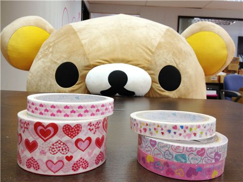 Rilakkuma senaking a peek at the cute heart deco tapes
