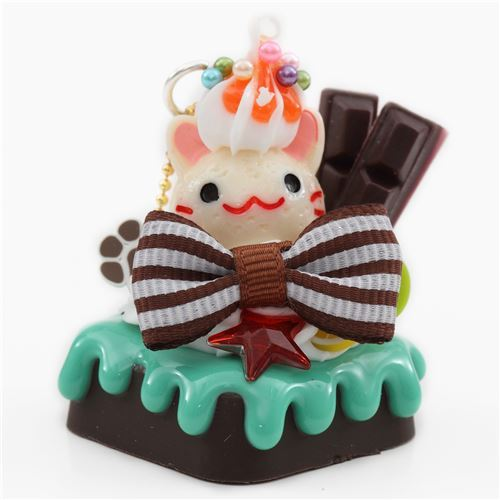 light cream color cat face brown bow chocolate fruit dessert figure from Japan