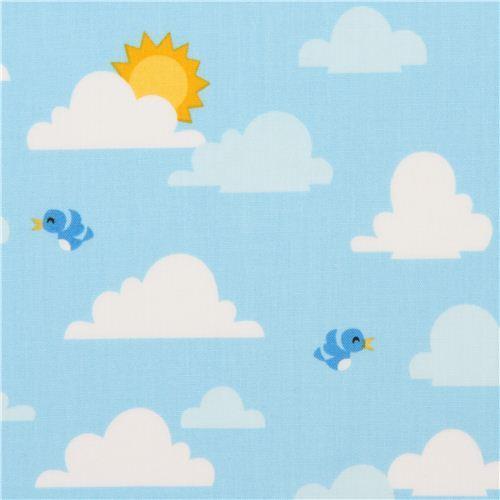 blue clouds sun and bird fabric by Robert Kaufman USA
