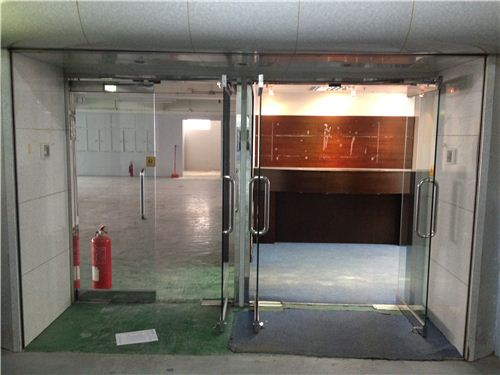 The new office even has two entry doors - office on the right, warehouse on the left