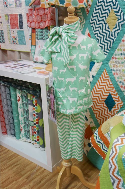 We love this two-piece in mint green made with birch fabric