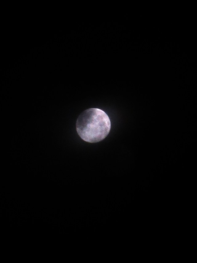 Great view of last night's SuperMoon with some cloud coverage.