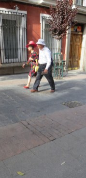 Couple walking in Madrid