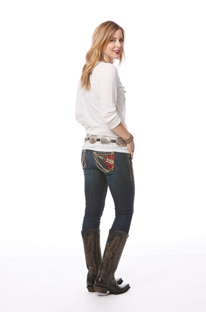Never tucks her bootcut jeans while branding cattle in Nevada.
