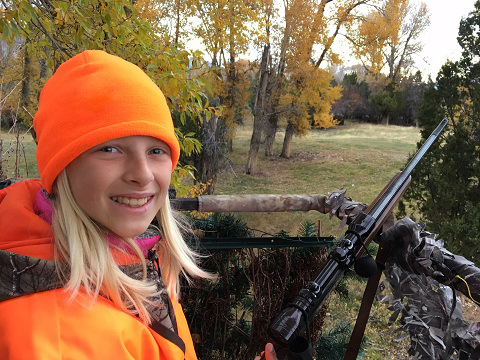 Girl deer hunting with dad