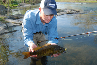 Jeff Murray with a smallmouth bass on the North Fork of the Shenandoah River