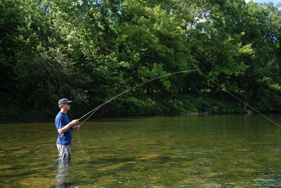 Jeff Murray hooks a high percentage of his streamer strikes by following the sweep of his streamer with the rod tip and setting the hook with his line hand as well as the fly rod.