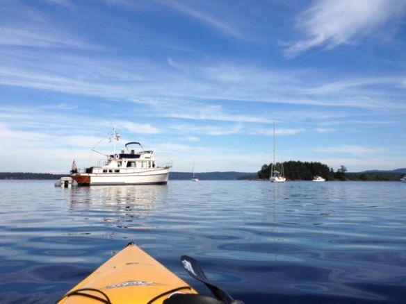mv Archimedes Kim kayaking in Clam Bay