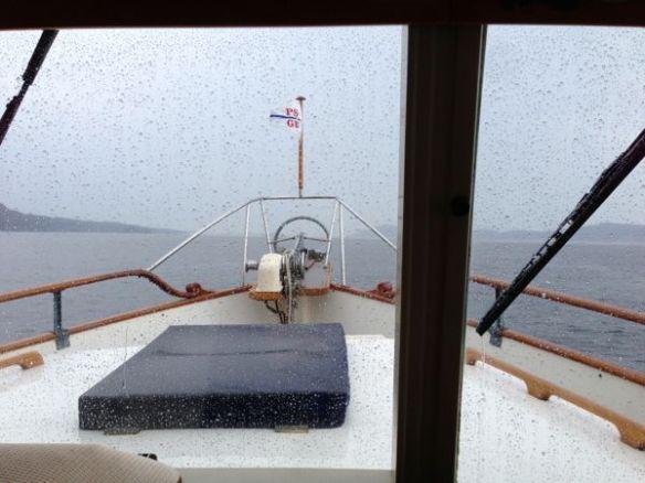 mv Archimedes motoring along in the rain